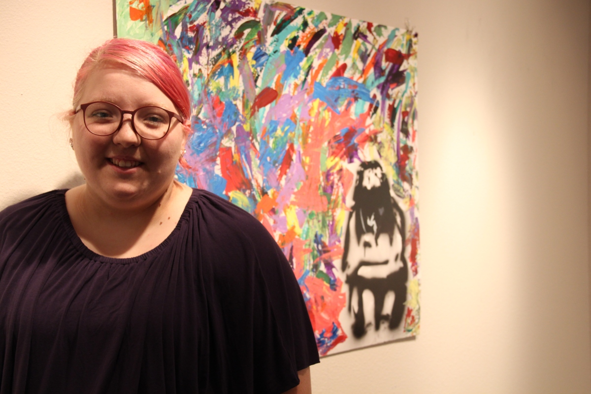Senior art show celebrates journey from homelessness to college graduation