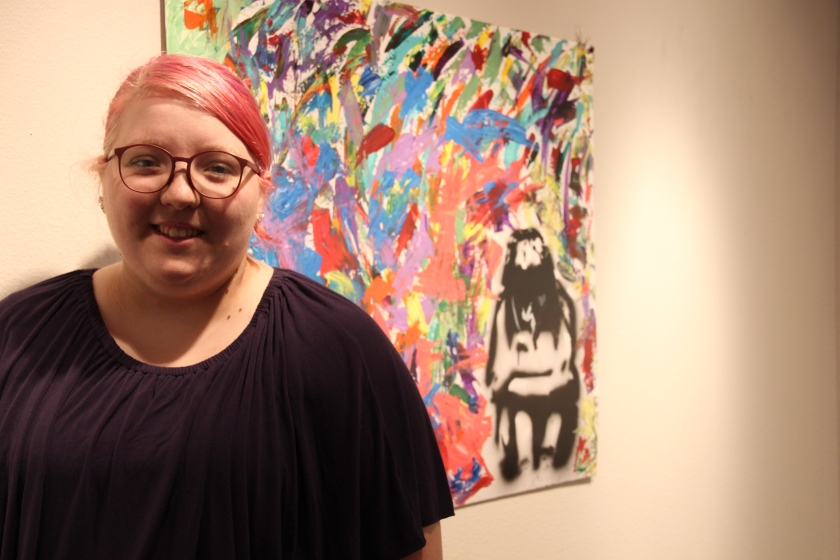 Senior art show celebrates journey from homelessness to college graduation