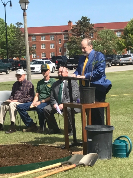 """In rememberance of the 168 killed April 19, 1995, along with honoring the survivors of the Murrah bombing, OBU participated in a special event that will continue the memory of those lost in the terrorist attack. Planted yesterday in an official ceremony by OBU President David Whitlock and a special committee, a seedling from the Survivor Tree now stands on the south lawn of Raley Chapel. Though little in size, the seedling is now as a memorial site and a reminder of the attack in OKC 22 years ago. """"Every year they take cuttings from the tree and grow seedlings and then donate them to organizations [that apply for one],"""" head of facilities management, George Haines said. """"[OBU] did this year and explained to them what our purpose was, why we wanted one of the seedlings. We thought that would be a fitting way to do our first arbor day here at OBU."""" Arbor Day is a holiday where people are encouraged to plant and take care of trees. Multiple countries celebrate this holiday, recognzing the need to take care of the trees that we have and encourage new growth. With that in mind, the seedling of the Survivor Tree will not be just another ordinary tree. """"The tree itself symbolizes so much itself,"""" head gardener Lisa Hair said. """"The American Elm is a huge, beautiful tree. It's going to be here for years and years to come."""" As a certified horticulturist, the surviving of the tree in the bombing meant a great deal to Hair. """"For a very brief time when the bombing took place, we weren't sure whether our niece and her son were in the building,"""" Hair said. """"All we knew is she worked a government job and she took her son, who had cerebral palsy, with her to work sometimes. So for about three hours till we heard from her, we were very hooked into the bombing. And when I heard the tree had survived, being a gardener, I was just ecstatic. Then when I heard they were doing seedlings from that tree, and they weren't just giving them to the survivor's families like the first year, I want"""