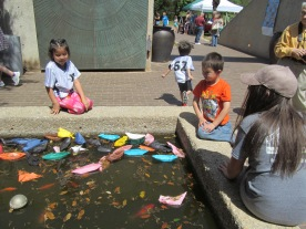 other children enjoyed setting their boats afloat in the fountain