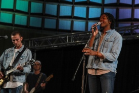 "Stage band singer Marcellus singing Young The Giant's ""I Got"" with band, The High Life."